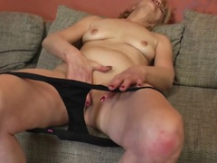 Naughty mature lady masturbating
