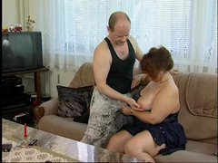 Mature couple having fun on a couch
