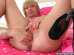 British milf Raven loves masturbating in fishnet stockings
