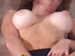 Mature brunette with nice tits fingers her pussy on floor
