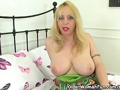 British and busty milf Lucy Gresty gives her mature pussy a workout