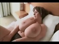 Sexy Mature Woman Shows Off Massive Boobs