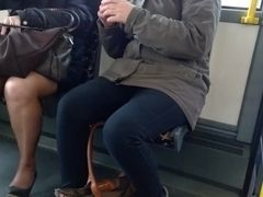 Mature with pretty high high-heeled slippers and stocking in the bus four