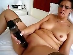 Mature girl and her massive toy