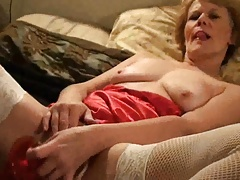 Masturbating with a red dildo