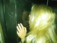Cheating witnesses wifey fellates big black cock at gloryhole