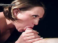 Thick woman in black giving oily handjob
