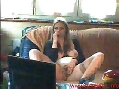 MILF playing with her pussy on the couch