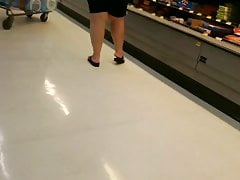 Plumper grandmother shopping and leaning