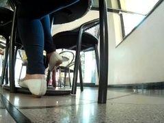 Candid shoeplay flats at club