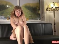 Experienced Doris source is posing naked close to will not hear of suntanned pantyhose