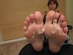 Mother shows feet and gets cum